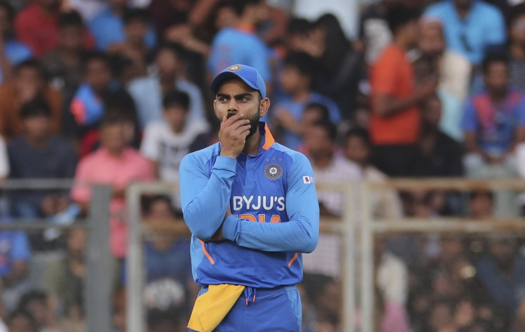India's captain Virat Kohli gestures during the first one-day international cricket match between India and Australia in Mumbai, India, Tuesday, Jan. ...