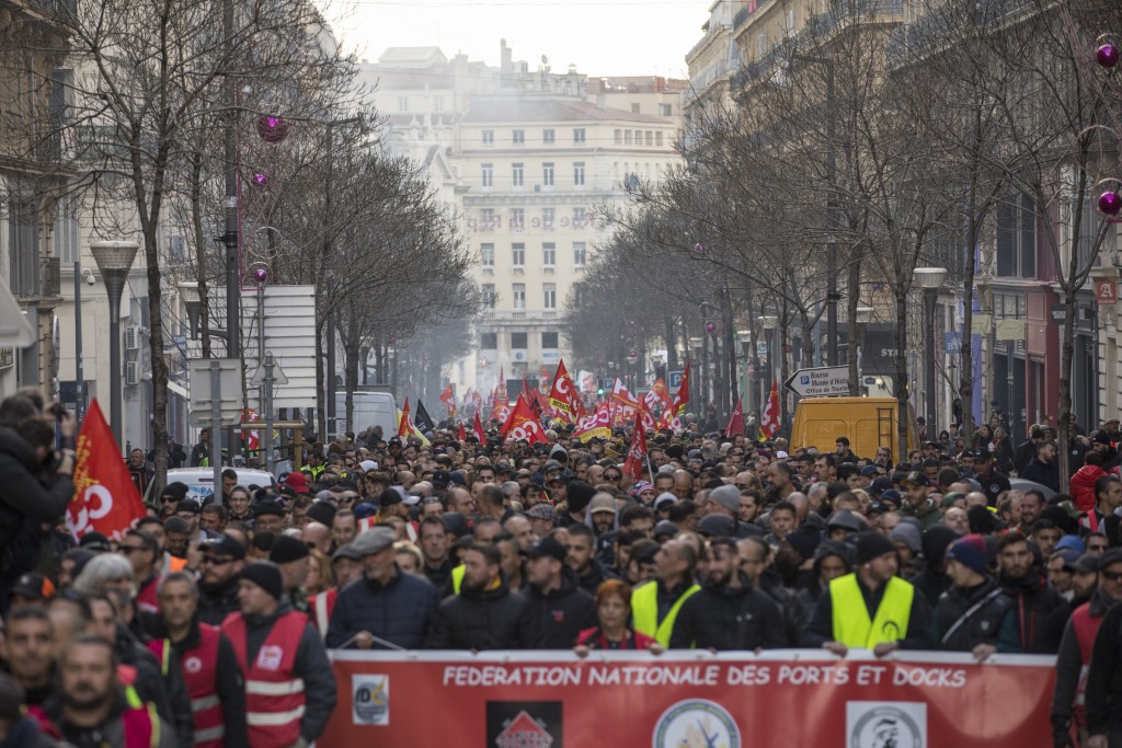 Strikers march during a demonstration Tuesday, Jan. 14, 2020, in Marseille, southern France. Rail workers, teachers, doctors, lawyers and others joine...