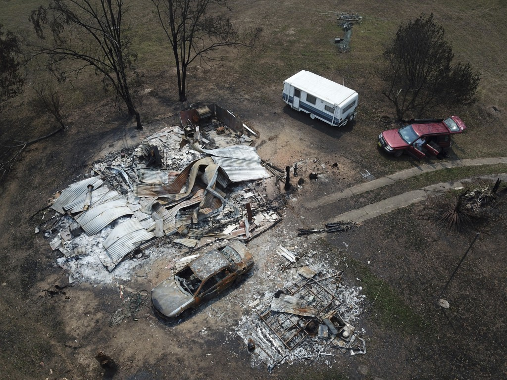 The home of Lyle Stewart is razed to the ground at Nerrigundah, Australia, Monday, Jan. 13, 2020, after a wildfire ripped through the town on New Year...