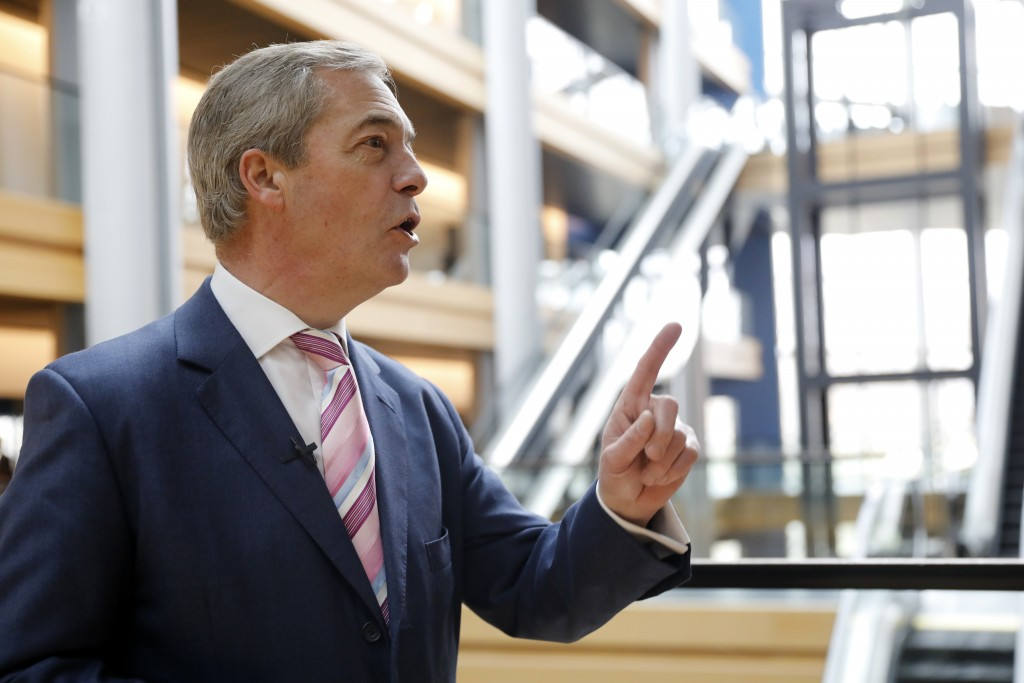 Nigel Farage, the leader of the Brexit Party, answers reporters at the European parliament Tuesday, Jan.14, 2020 in Strasbourg, eastern France. (AP Ph...