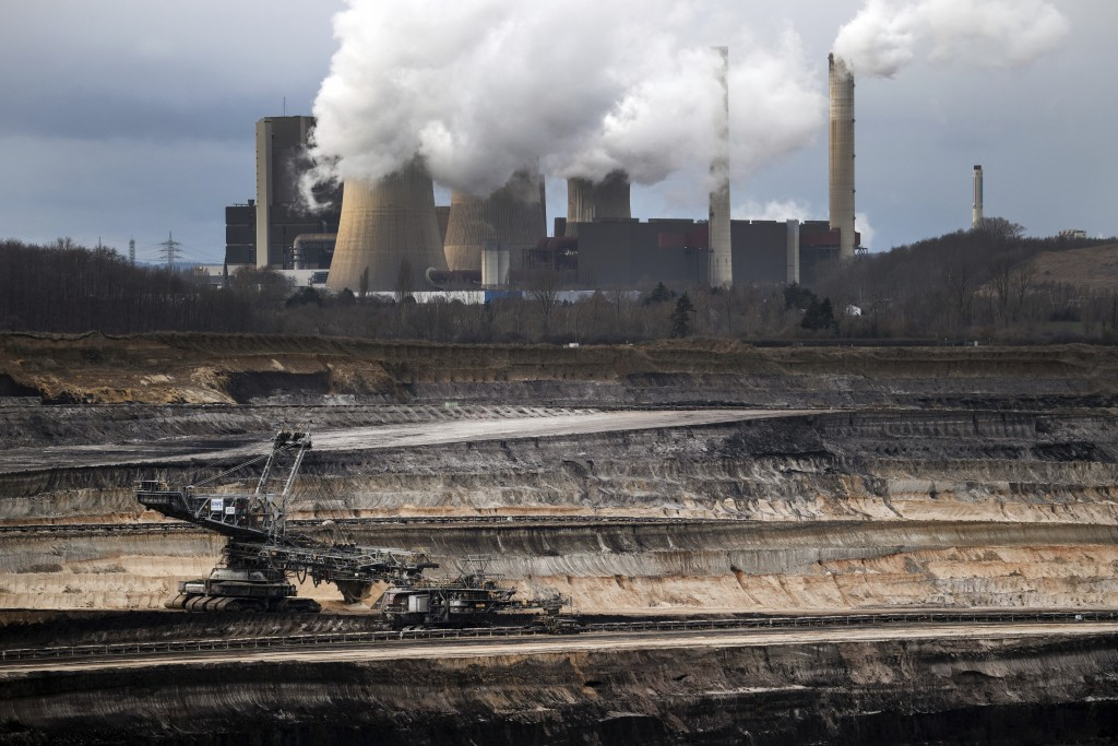 A mining machine is working in the Inden opencast lignite mine in Schophoven, Germany, Tuesday, Jan.14, 2020. In the background is the Weisweiler lign...