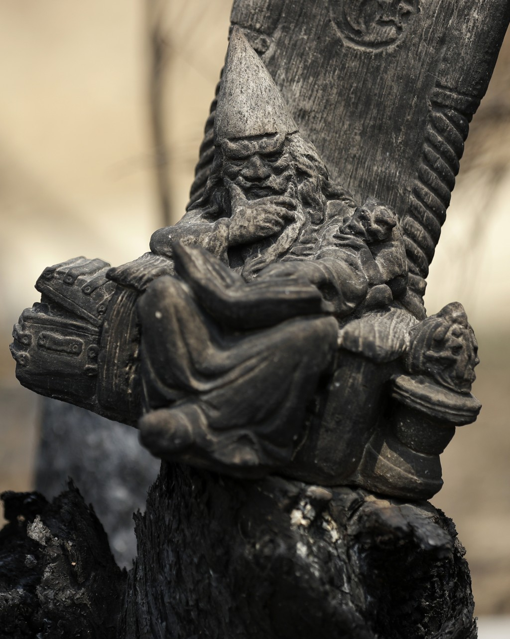 A blackened wizard ornament sits in a scorched fencepost at Nerrigundah, Australia, Monday, Jan. 13, 2020, after a wildfire ripped through the town on...