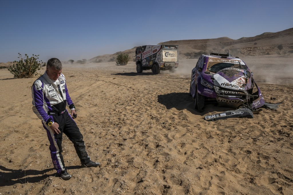 Co-driver Michael Orr, of Great Britain, after crashing his Toyota during stage nine of the Dakar Rally between Wadi Al Dawasir and Haradth, Saudi Ara...