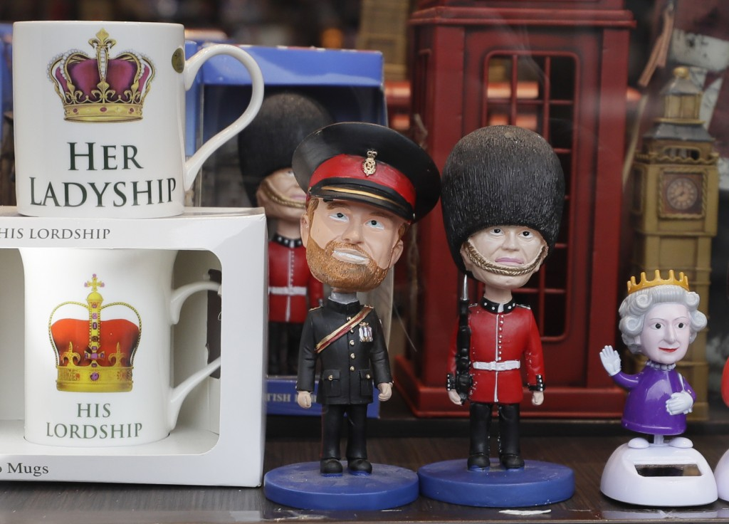 Models of Britain's Queen Elizabeth II, right, and Prince Harry, left, are displayed in the window of a souvenir shop in London, Tuesday, Jan. 14, 202...