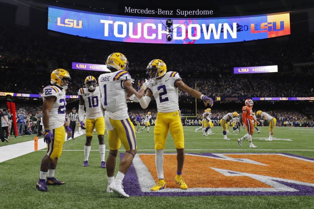 LSU wide receiver Ja'Marr Chase (1) celebrates after scoring with wide receiver Justin Jefferson during the first half of a NCAA College Football Play...