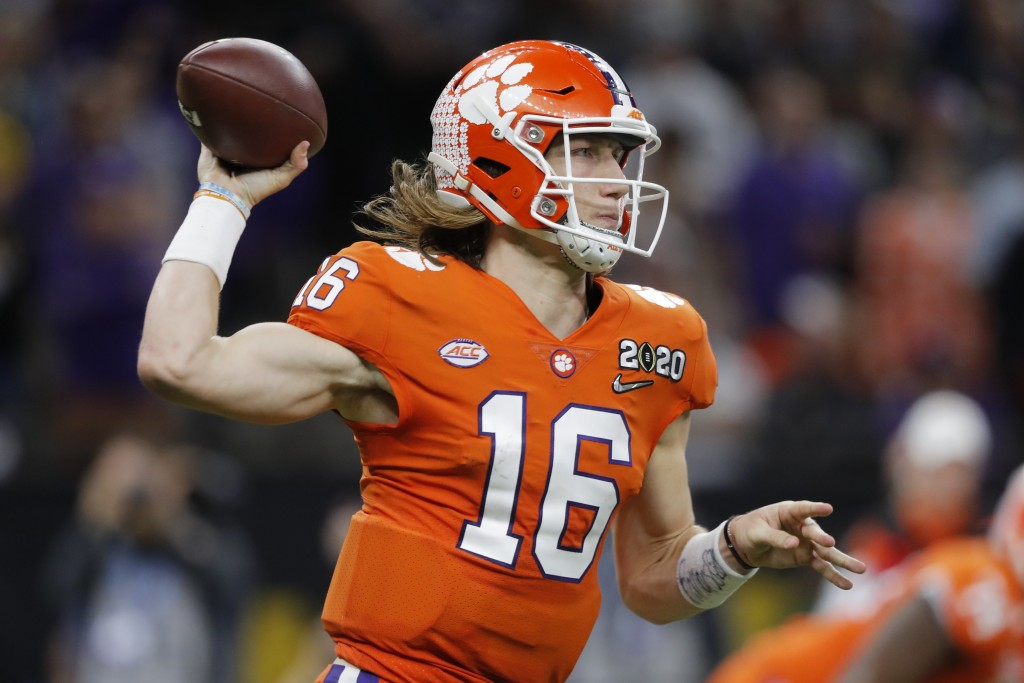 Clemson quarterback Trevor Lawrence passes against LSU during the second half of a NCAA College Football Playoff national championship game Monday, Ja...