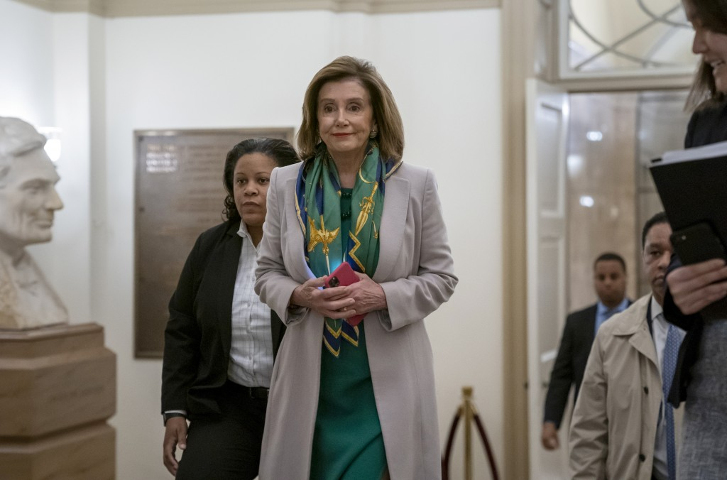 Speaker of the House Nancy Pelosi, D-Calif., arrives to meet with the Democratic Caucus at the Capitol in Washington, Tuesday, Jan. 14, 2020. Pelosi, ...