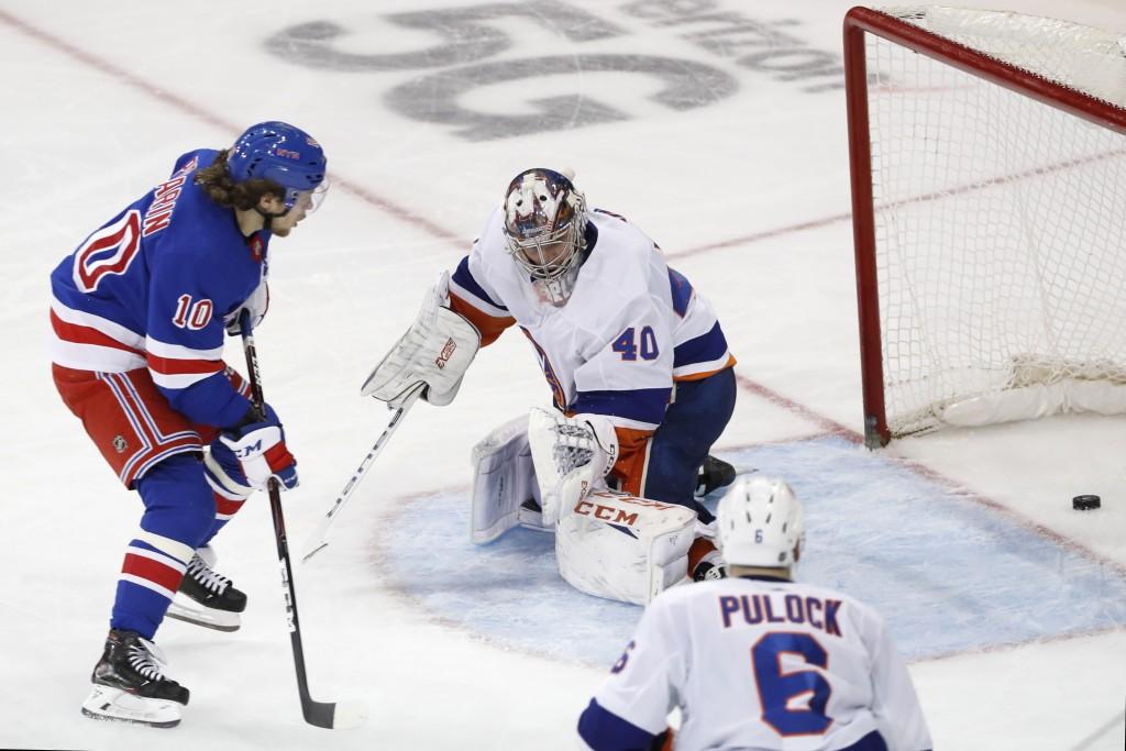 CORRECTS FINAL SCORE TO 6-2 NOT 6-1 New York Rangers left wing Artemi Panarin (10) watches his goal slide past New York Islanders goaltender Semyon Va...