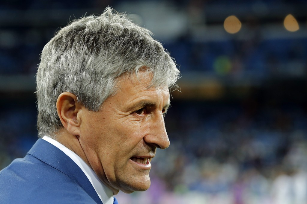FILE - In this Wednesday, March 1, 2017 file photo, Las Palmas coach Quique Setien waits for the start of a Spanish La Liga soccer match between Real ...