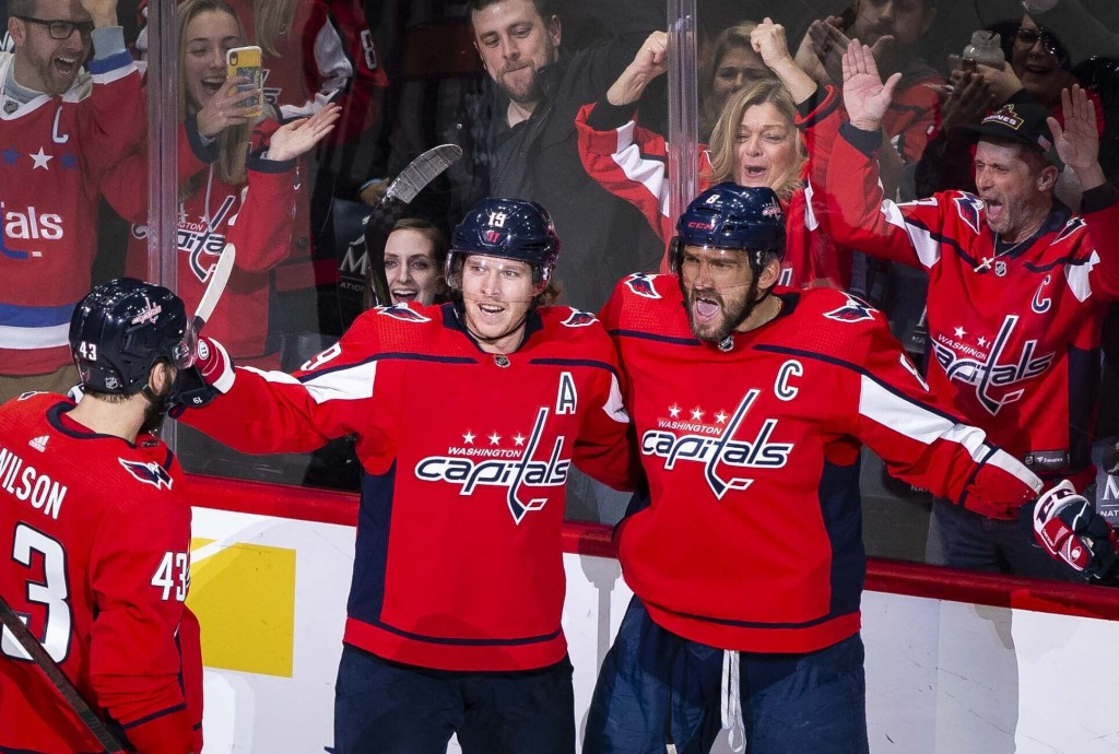 Washington Capitals left wing Alex Ovechkin (8), from Russia, celebrates after scoring as right wing Tom Wilson (43), from Canada, and Nicklas Backstr...