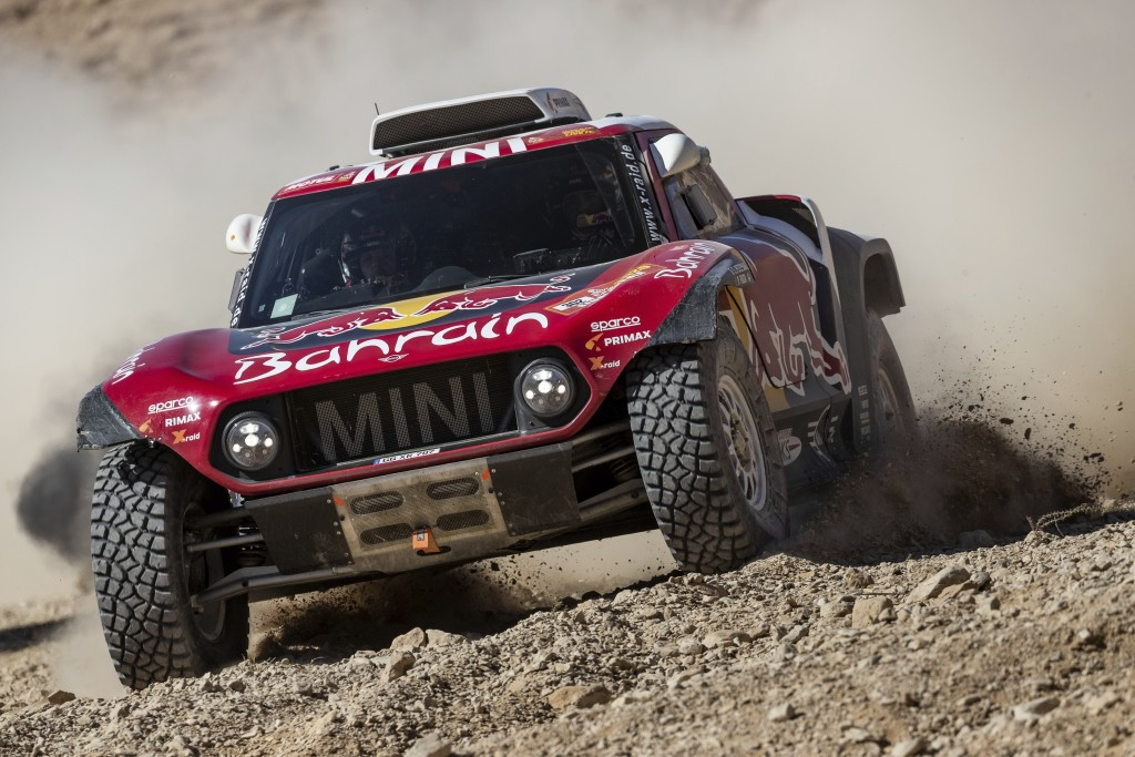 Driver Stephane Peterhansel, of France, and co-driver Paulo Fiuza, of Portugal, race their Miniduring stage nine of the Dakar Rally between Wadi Al Da...