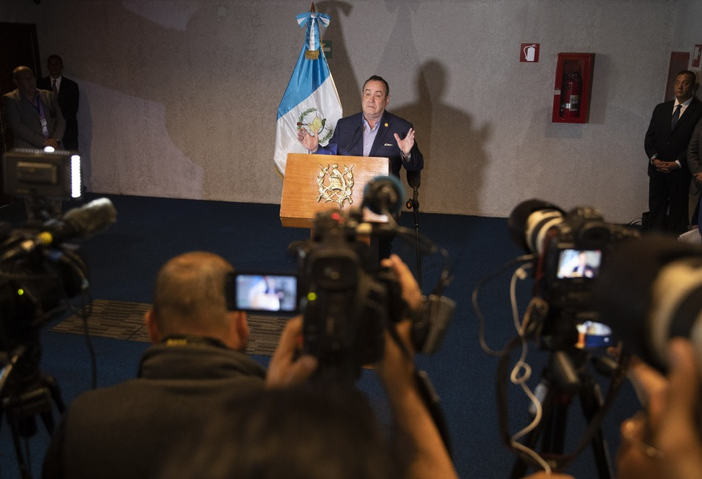 Guatemala's President-elect Alejandro Giammattei gives a press conference at the National Theatre, the day before his inauguration in Guatemala City, ...