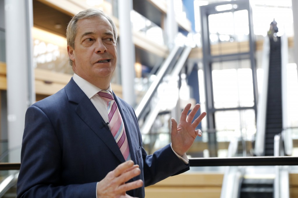 Britain's Nigel Farage, the leader of the Brexit Party, answers reporters at the European parliament Tuesday, Jan.14, 2020 in Strasbourg, eastern Fran...