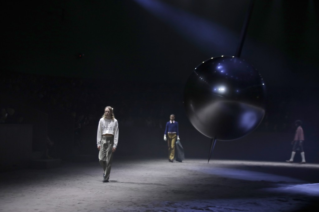Models wear creations as part of the Gucci men's Fall-Winter 2020/21 collection, that was presented in Milan, Italy, Tuesday, Jan. 14, 2020. (AP Photo...