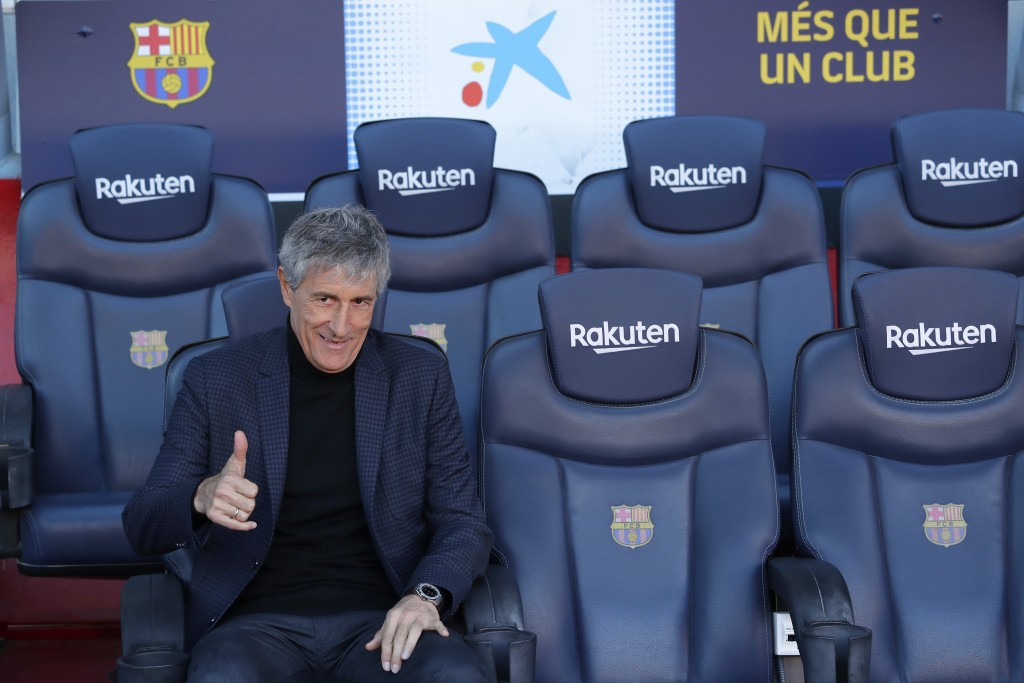 Quique Setien poses on the bench after being officially introduced as the new soccer coach of FC Barcelona at the Camp Nou stadium in Barcelona, Spain...