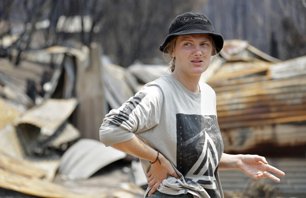 Skye Threlfall talks about how she and her brother and sister saved their house a New Year's Eve wildfire at Nerrigundah, Australia, Monday, Jan. 13, ...