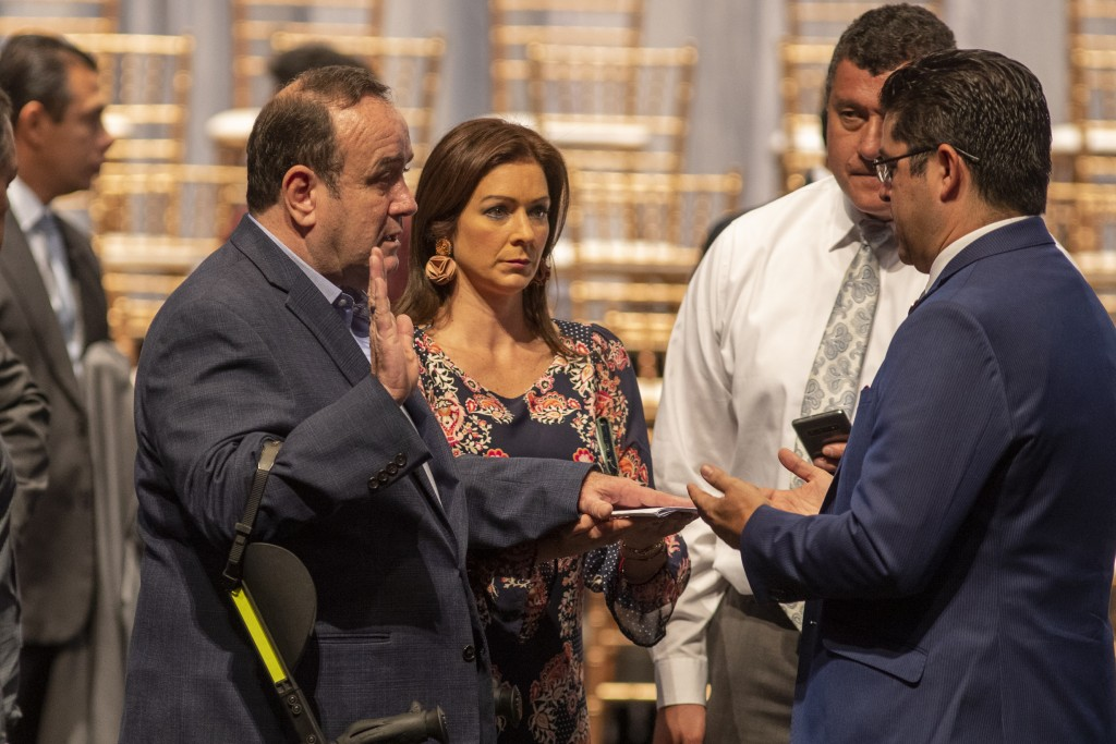 Guatemala's President-elect Alejandro Giammattei, left, attends a rehearsal of his swearing-in ceremony at the National Theatre, the day before his in...