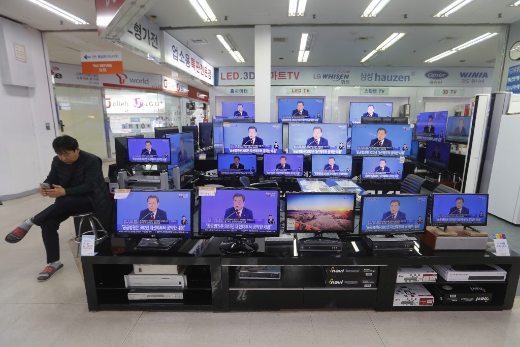 TV screens show the live broadcast of South Korean President Moon Jae-in's New Year press conference at the Yongsan Electronic store in Seoul, South K...