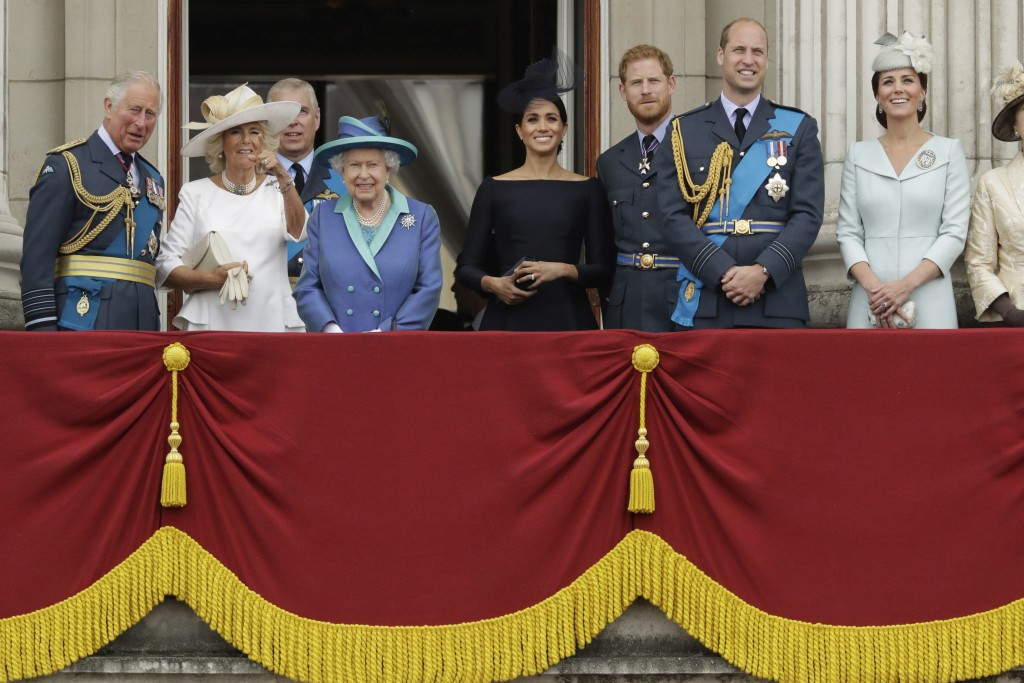 FILE - In this Tuesday, July 10, 2018 file photo, members of the royal family gather on the balcony of Buckingham Palace, with from left, Prince Charl...