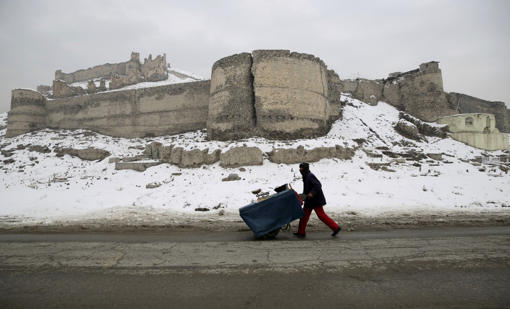 An Afghan street vendor pulls his hand cart after a heavy snowfall in Kabul, Afghanistan, Tuesday, Jan. 14, 2020. Severe winter weather has struck par...
