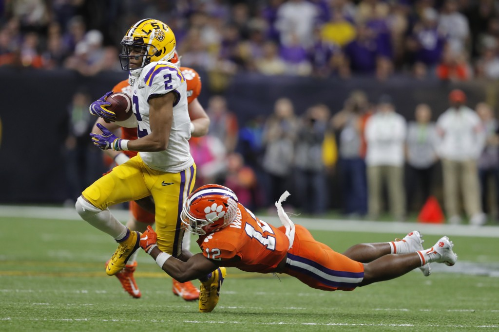 LSU wide receiver Justin Jefferson is tackled by Clemson safety K'Von Wallace during the second half of a NCAA College Football Playoff national champ...