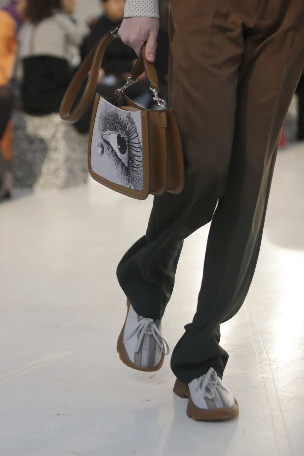 A model wears a creation as part of the Marco De Vincenzo men's Fall-Winter 2020/21 collection, that was presented in Milan, Italy, Tuesday, Jan. 14, ...