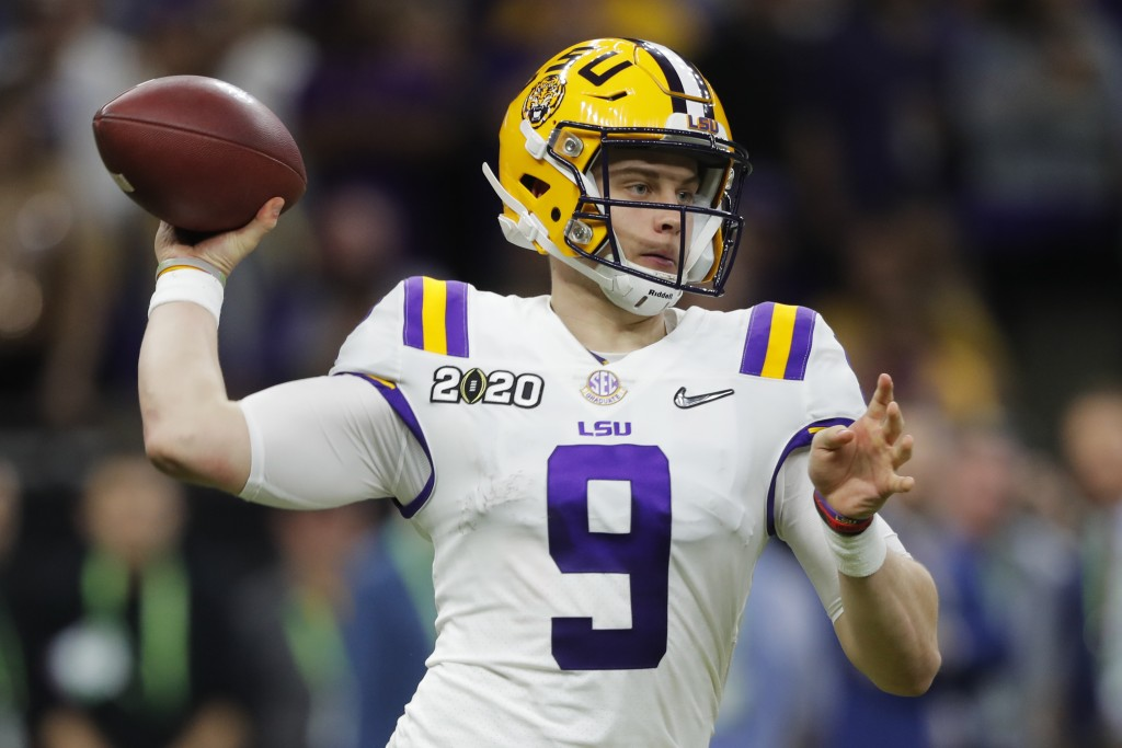 LSU quarterback Joe Burrow passes against Clemson during the second half of a NCAA College Football Playoff national championship game Monday, Jan. 13...