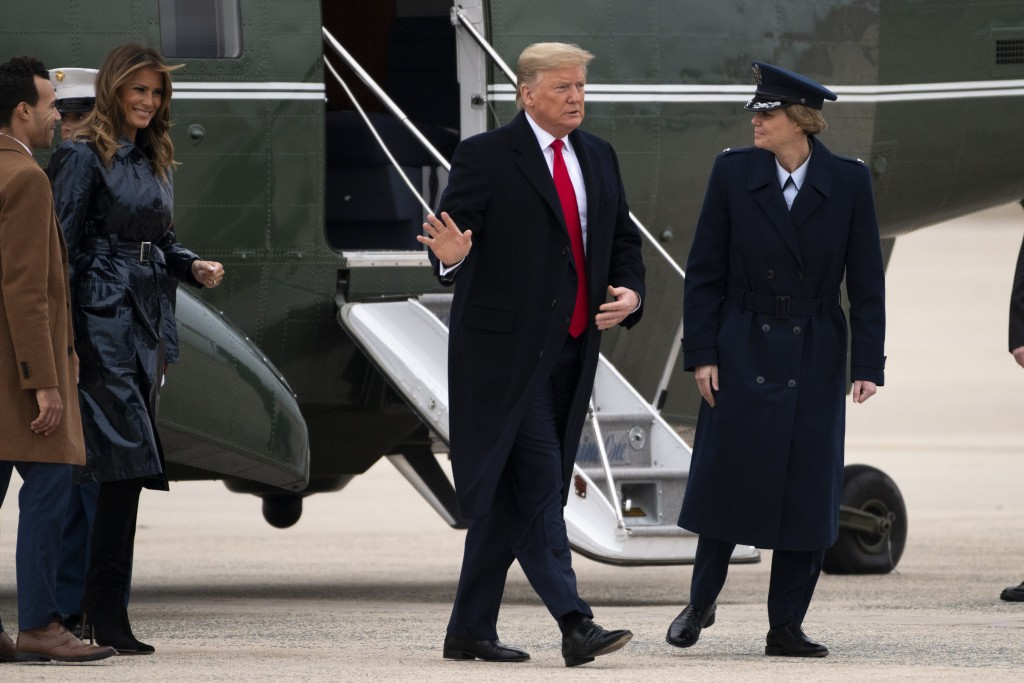 President Donald Trump and first lady Melania Trump exit Marine One on Monday, Jan. 13, 2020, at Andrews Air Force Base, Md., as he travels to attend ...