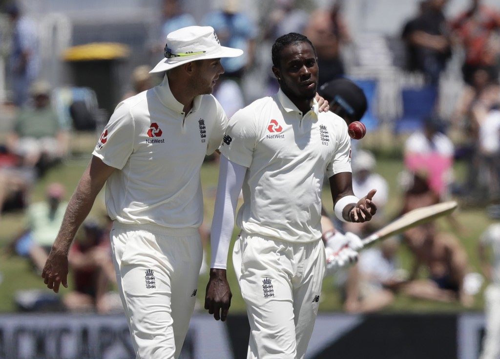FILE- In this Nov. 24, 2019 file photo, England's Stuart Broad, left, chats with teammate Jofra Archer during play on day four of the first cricket te...