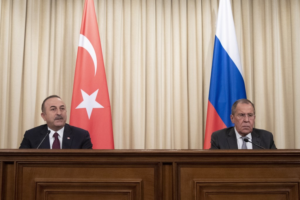 Turkish Foreign Minister Mevlut Cavusoglu, left, and Russian Foreign Minister Sergey Lavrov attend a joint news conference following their talks in Mo...