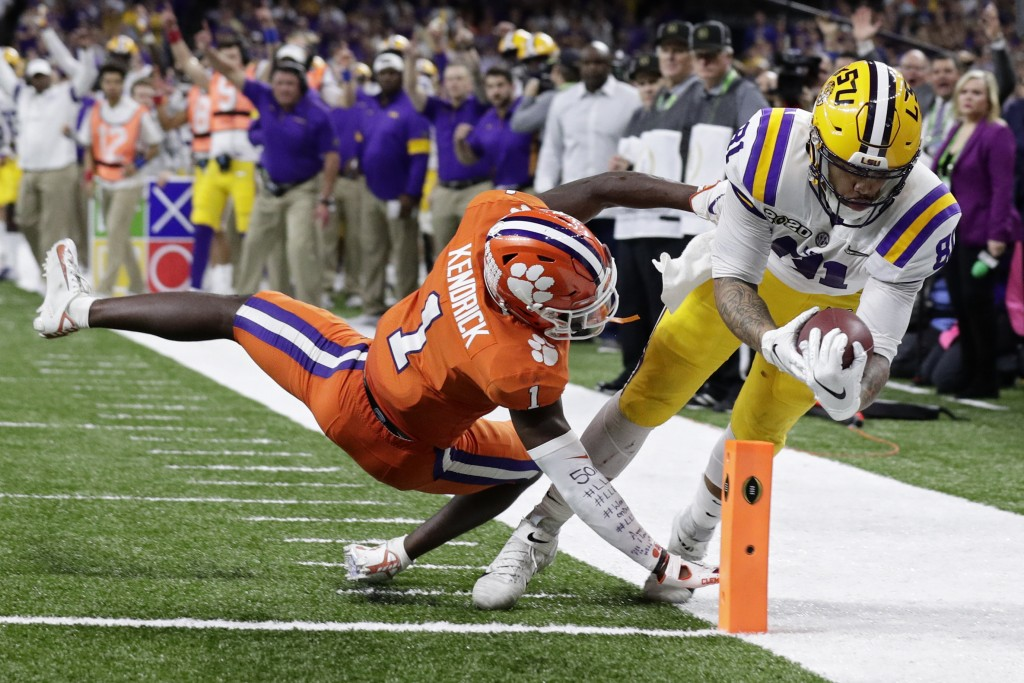 LSU tight end Thaddeus Moss scores a touchdown past Clemson cornerback Derion Kendrick during the second half of a NCAA College Football Playoff natio...
