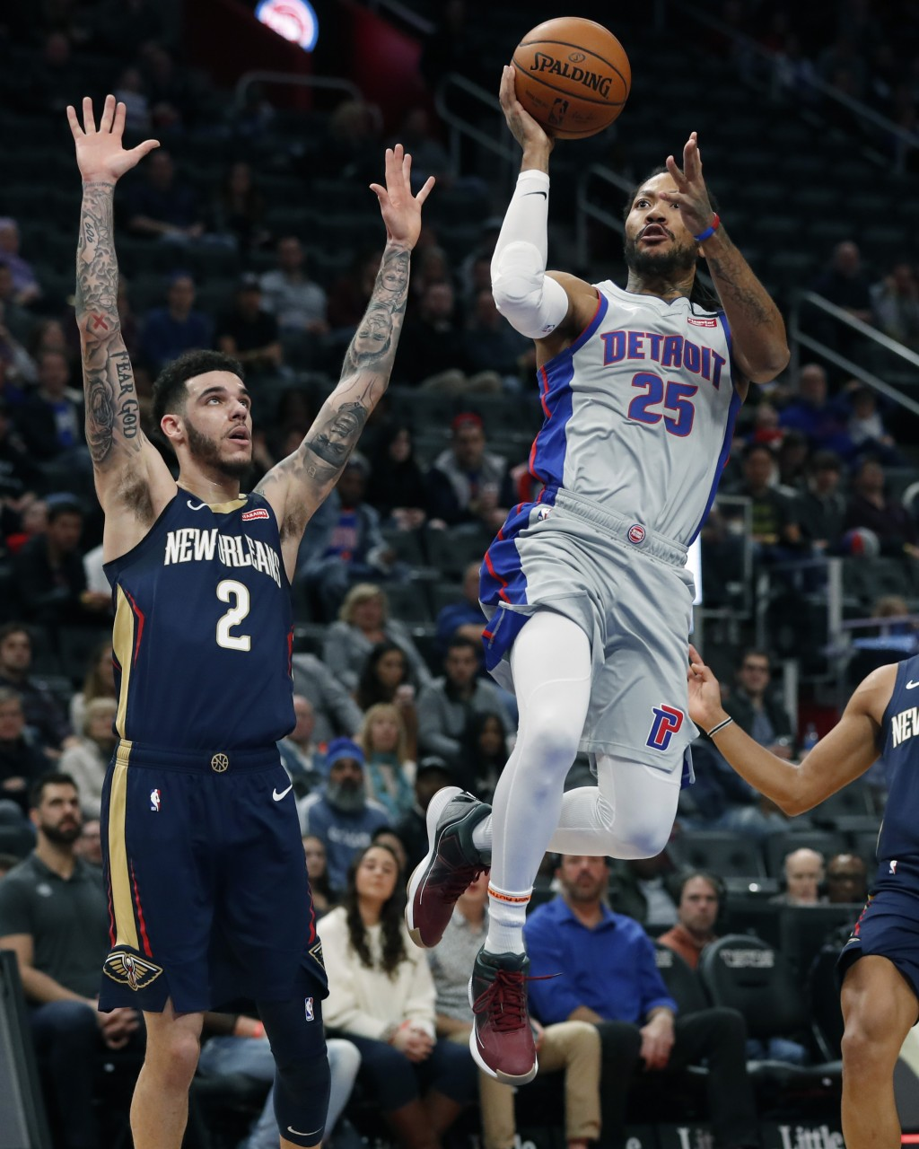 Detroit Pistons guard Derrick Rose (25) attempts a layup as New Orleans Pelicans guard Lonzo Ball (2) defends during the first half of an NBA basketba...