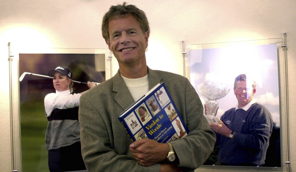 FILE - In this Aug. 21, 2003 file photo Alastair Johnston, vice chairman of IMG, poses outside his office with one of his books in Cleveland. Johnston...