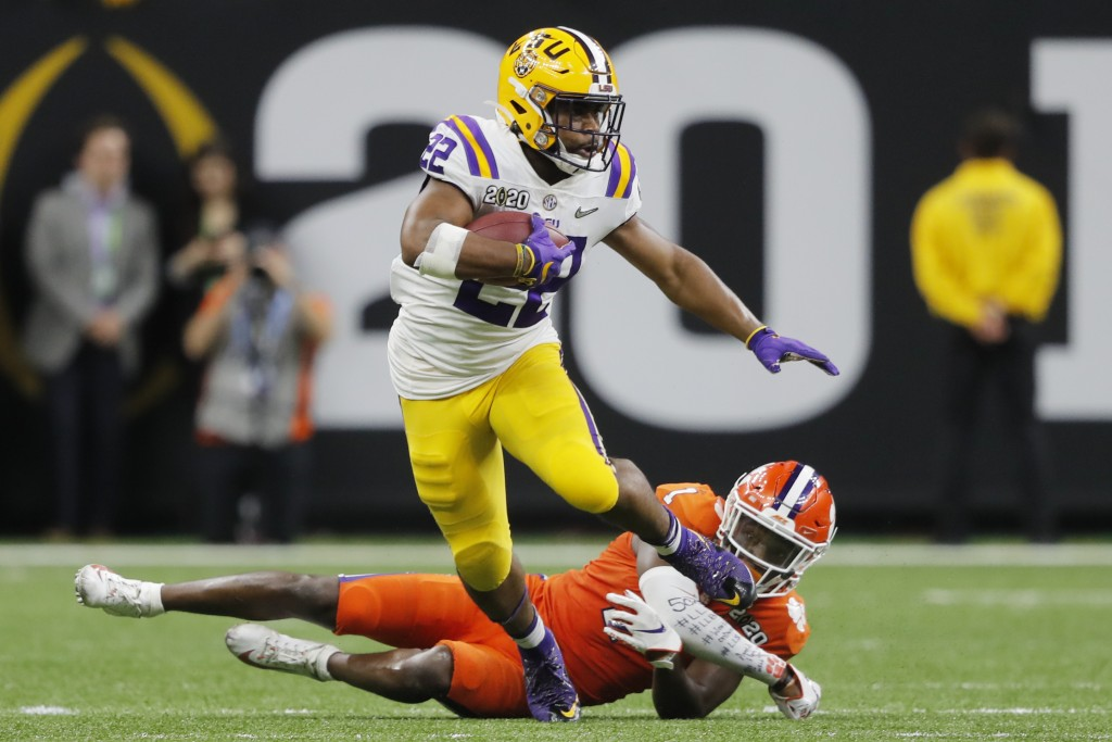 LSU running back Clyde Edwards-Helaire breaks away from Clemson cornerback Derion Kendrick during the second half of a NCAA College Football Playoff n...