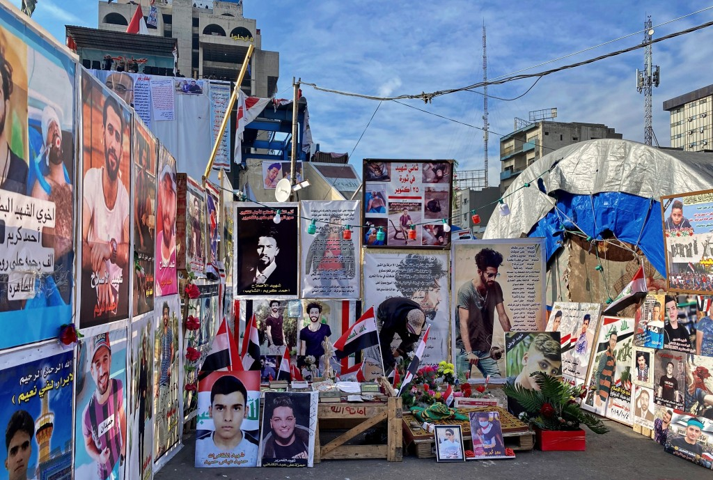 In this Monday, Jan. 13, 2020 photo, posters of anti-government protesters who have been killed in demonstrations are displayed in Tahrir Square durin...