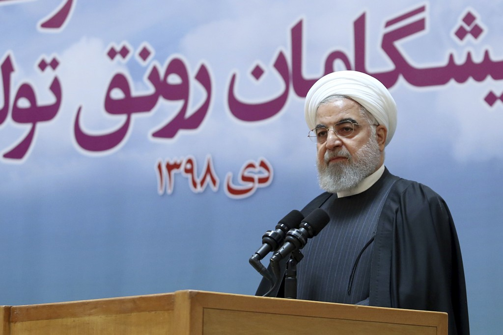 In this photo released by official website of the Office of the Iranian Presidency, President Hassan Rouhani speaks in a meeting in Tehran, Iran, Tues...