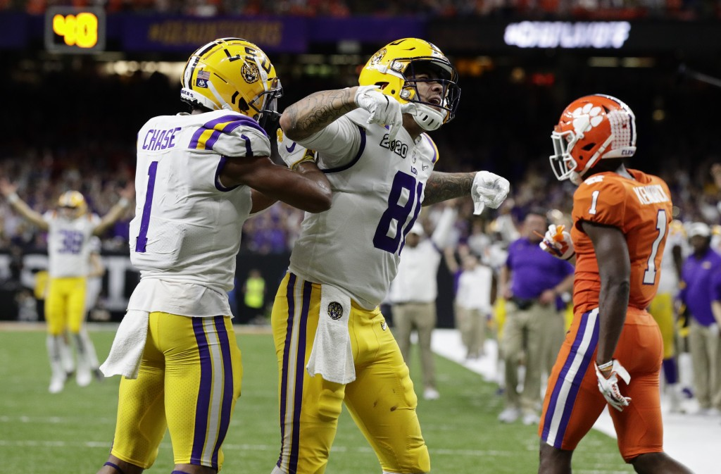 LSU tight end Thaddeus Moss, center, celebrates after scoring with wide receiver Ja'Marr Chase during the second half of a NCAA College Football Playo...