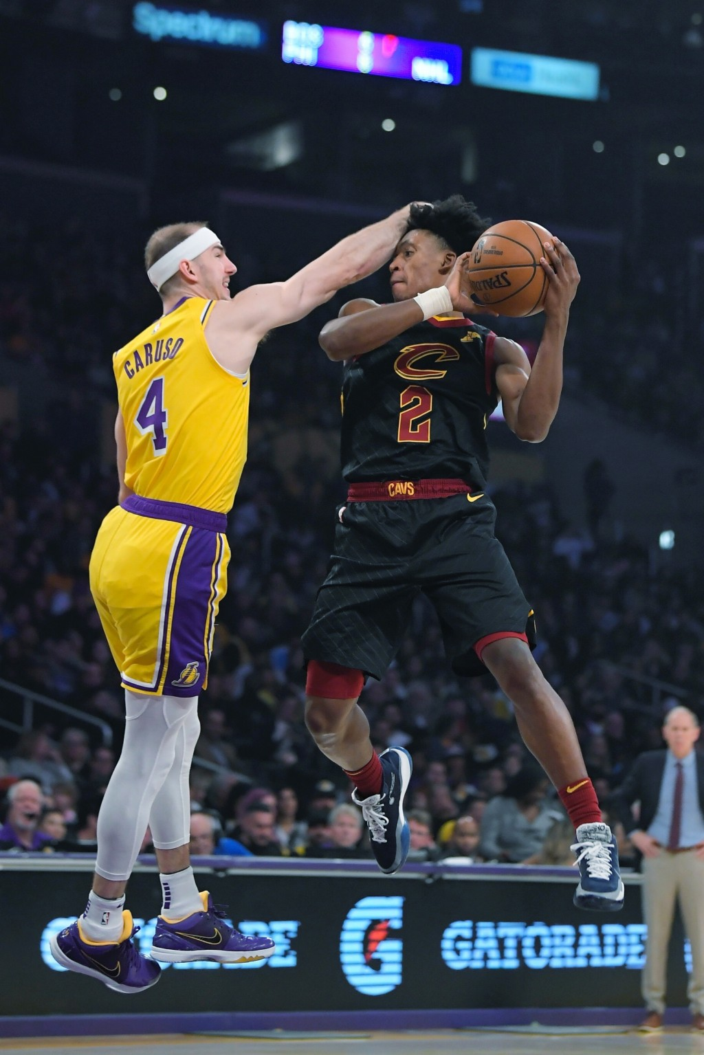 Cleveland Cavaliers guard Kevin Porter Jr., right, shoots as Los Angeles Lakers guard Alex Caruso defends during the first half of an NBA basketball g...