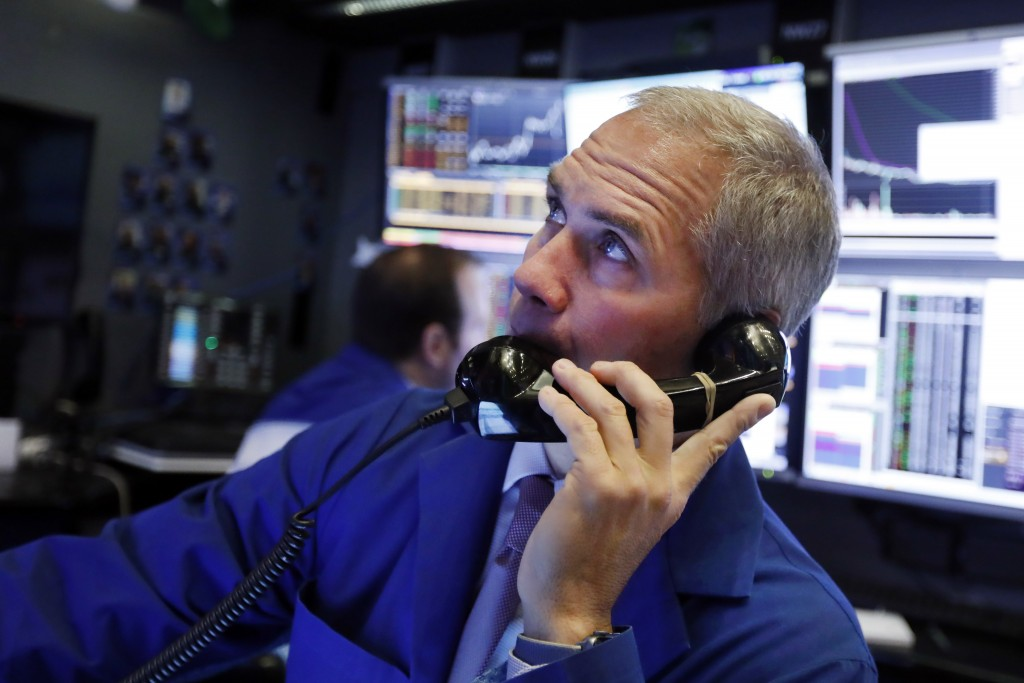 FILE - In this Jan. 9, 2020, file photo trader Timothy Nick works in his booth on the floor of the New York Stock Exchange. The U.S. stock market open...