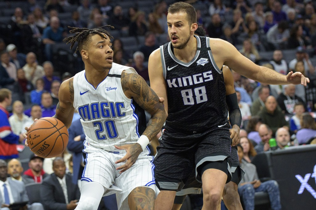 Orlando Magic guard Markelle Fultz (20) is defended by Sacramento Kings forward Nemanja Bjelica (88) during the first quarter of an NBA basketball gam...