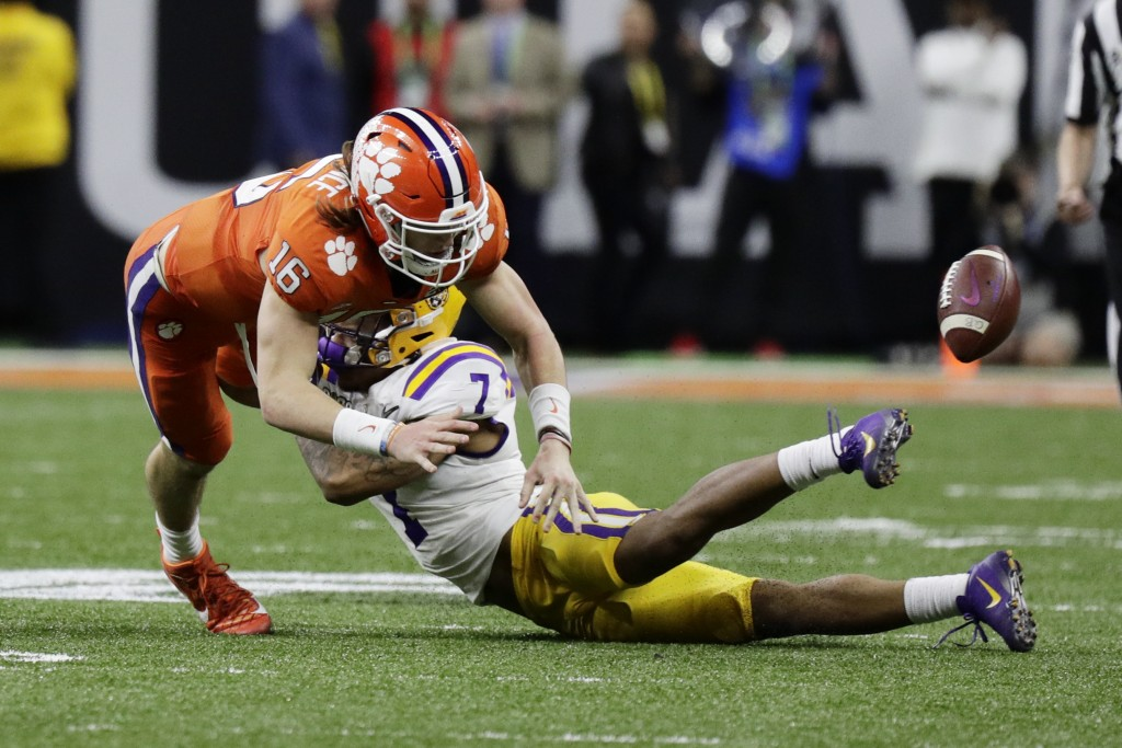 LSU safety Grant Delpit forces a fumble by Clemson quarterback Trevor Lawrence during the second half of a NCAA College Football Playoff national cham...