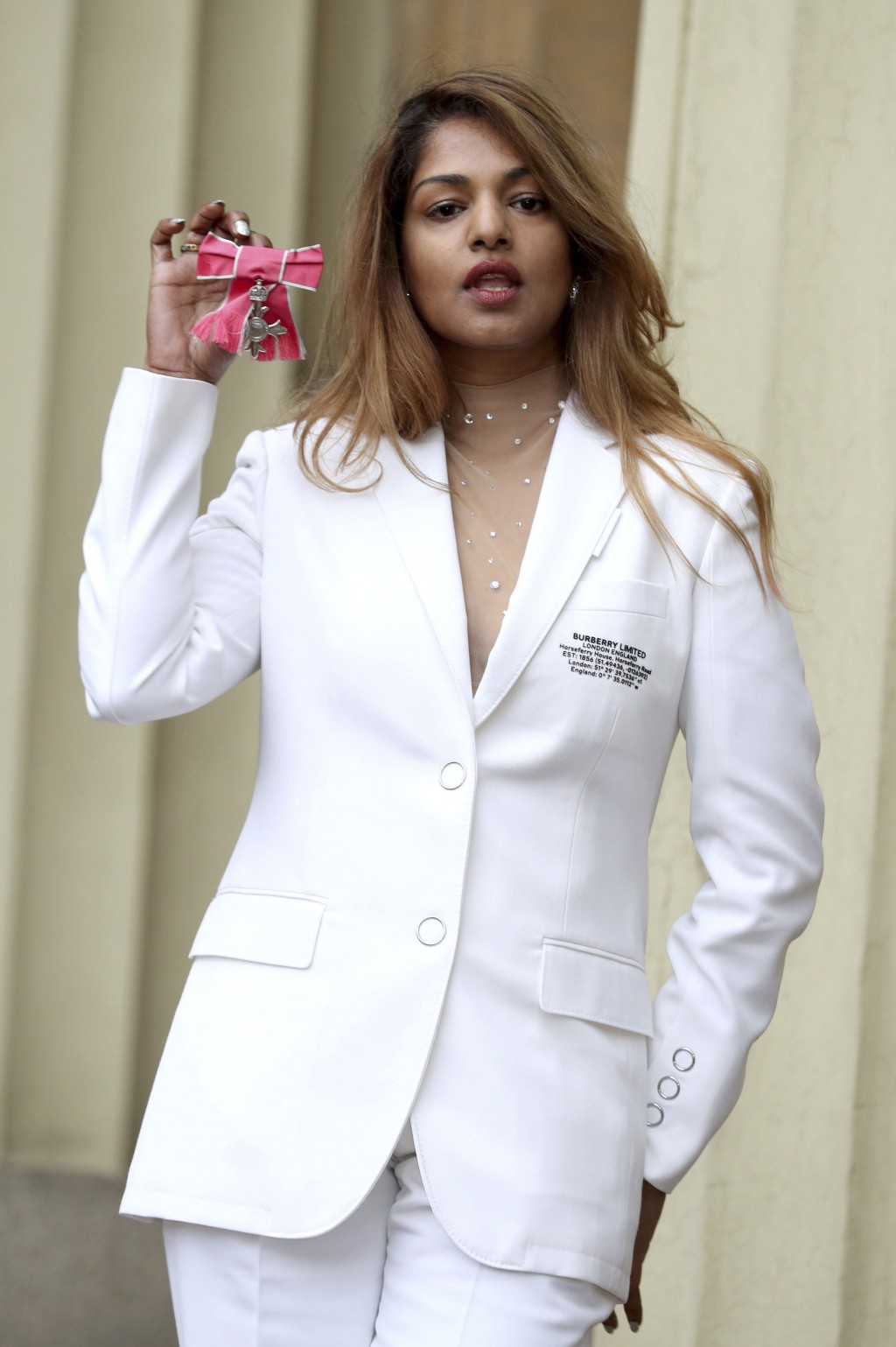 Rapper and singer MIA, real name Mathangi Arulpragasam, poses with her MBE award following an investiture ceremony at Buckingham Palace in London, Tue...