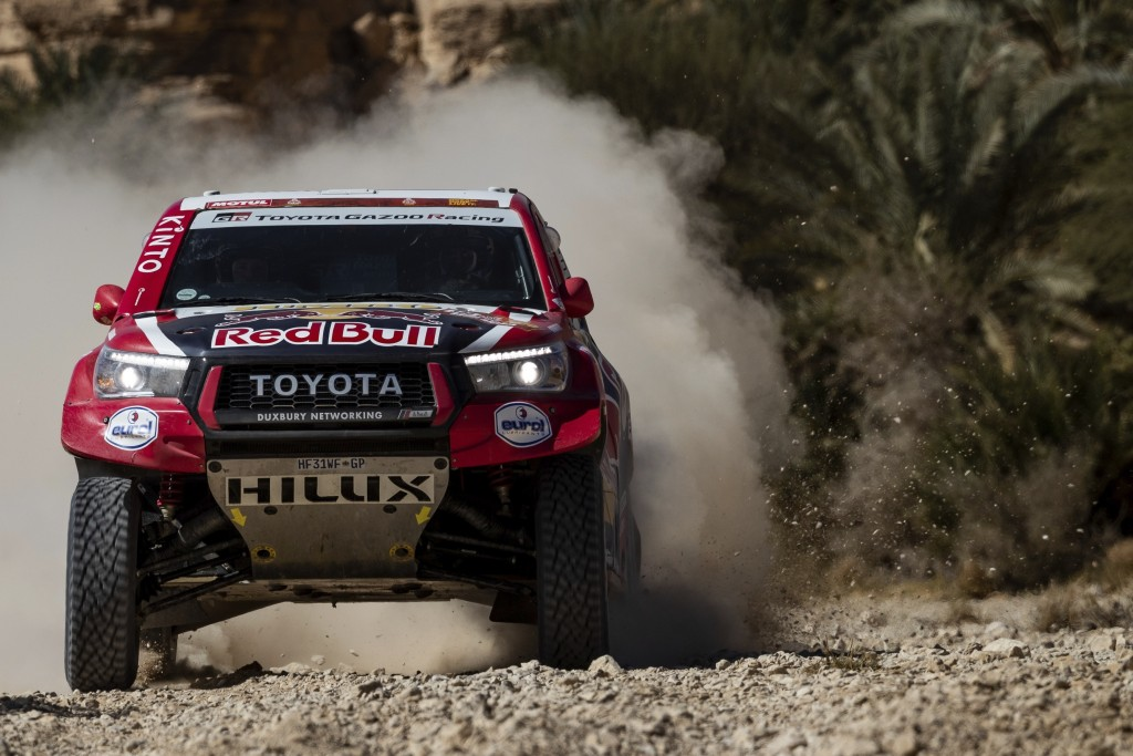 Driver Nasser Al-Attiyah, of Qatar, and co-driver Matthieu Baumel, of France, race their Toyota during stage nine of the Dakar Rally between Wadi Al D...