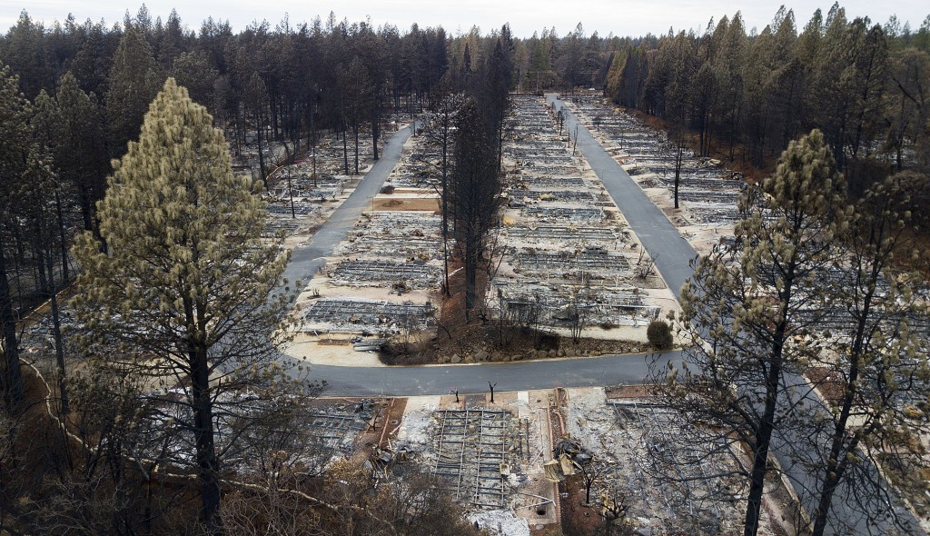 File - In this Dec. 3, 2018, file photo, are homes leveled by the Camp Fire line the Ridgewood Mobile Home Park retirement community in Paradise, Cali...