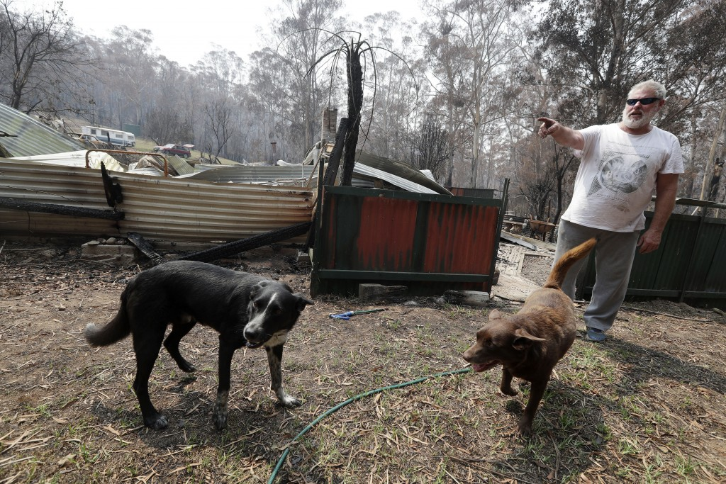 Lyle Stewart stands in front of his destroyed home at Nerrigundah, Australia, Monday, Jan. 13, 2020, after a wildfire ripped through the town on New Y...