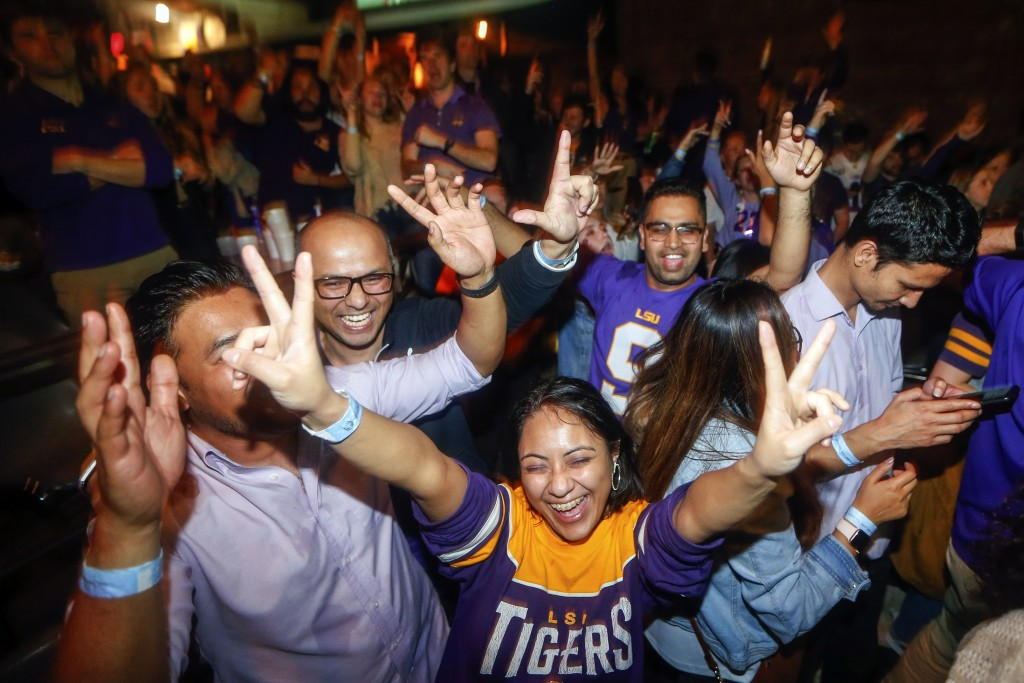 LSU fans celebrate at Varsity Theatre, in Baton Rouge, La., after LSU defeated Clemson 42-25 in the NCAA College Football Playoff championship game, M...