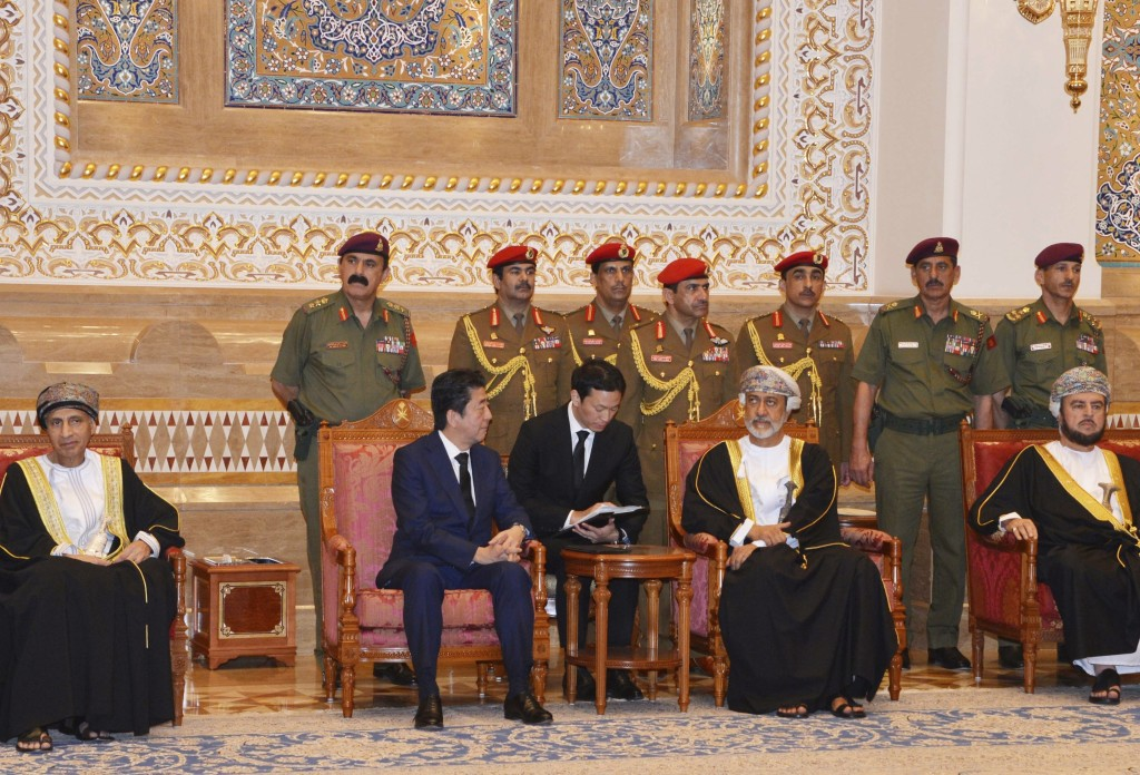 In this photo made available by Oman News Agency, Oman's Sultan Haitham bin Tariq Al Said, center right, receives Japan's prime minister Shinzo Abe af...