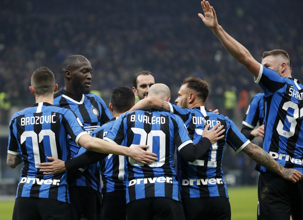 Inter Milan's Borja Valero, center, celebrates with teammates after scoring his side's second goal during an Italian Cup soccer match between Inter Mi...