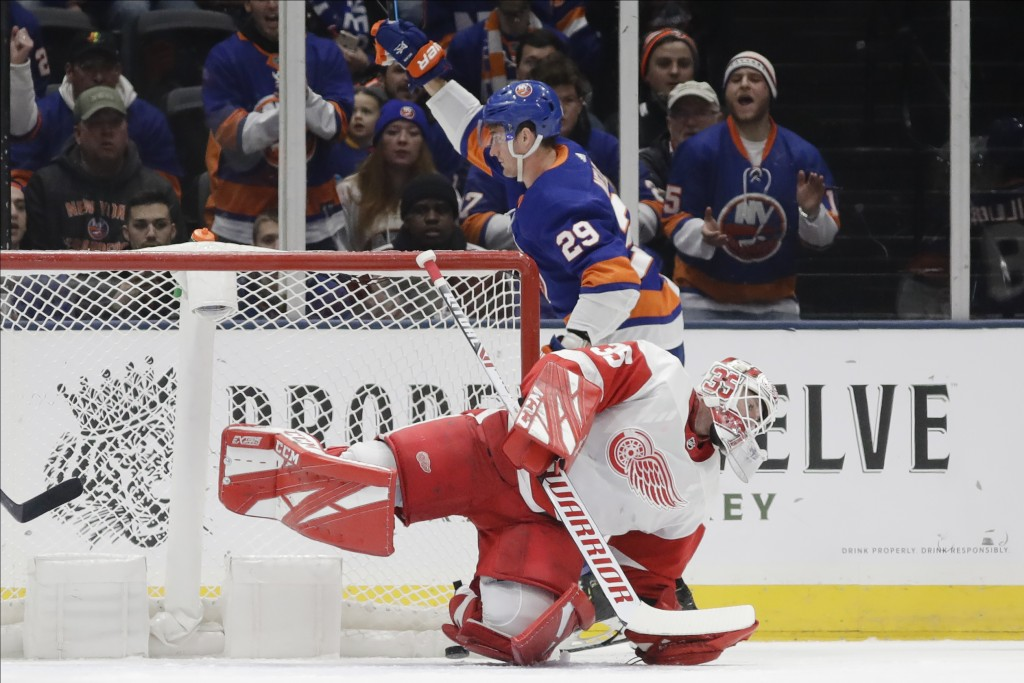New York Islanders' Brock Nelson (29) celebrates as Detroit Red Wings goaltender Jimmy Howard (35) reacts after Nelson scored a goal during the first ...