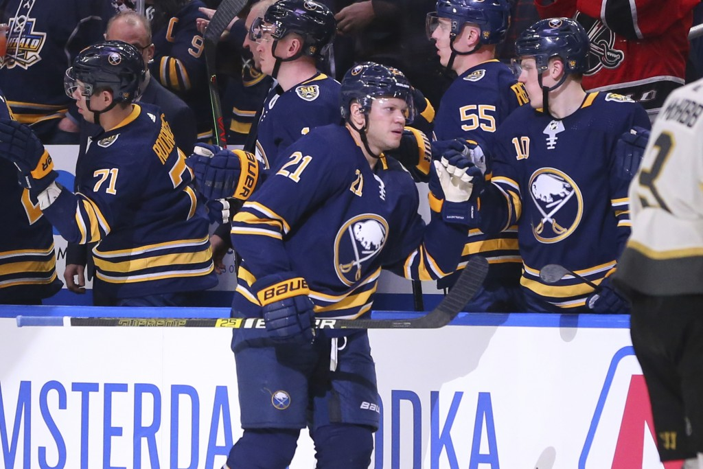 Buffalo Sabres forward Kyle Okposo (21) celebrates his goal during the second period of an NHL hockey game against the Vegas Golden Knights, Tuesday, ...